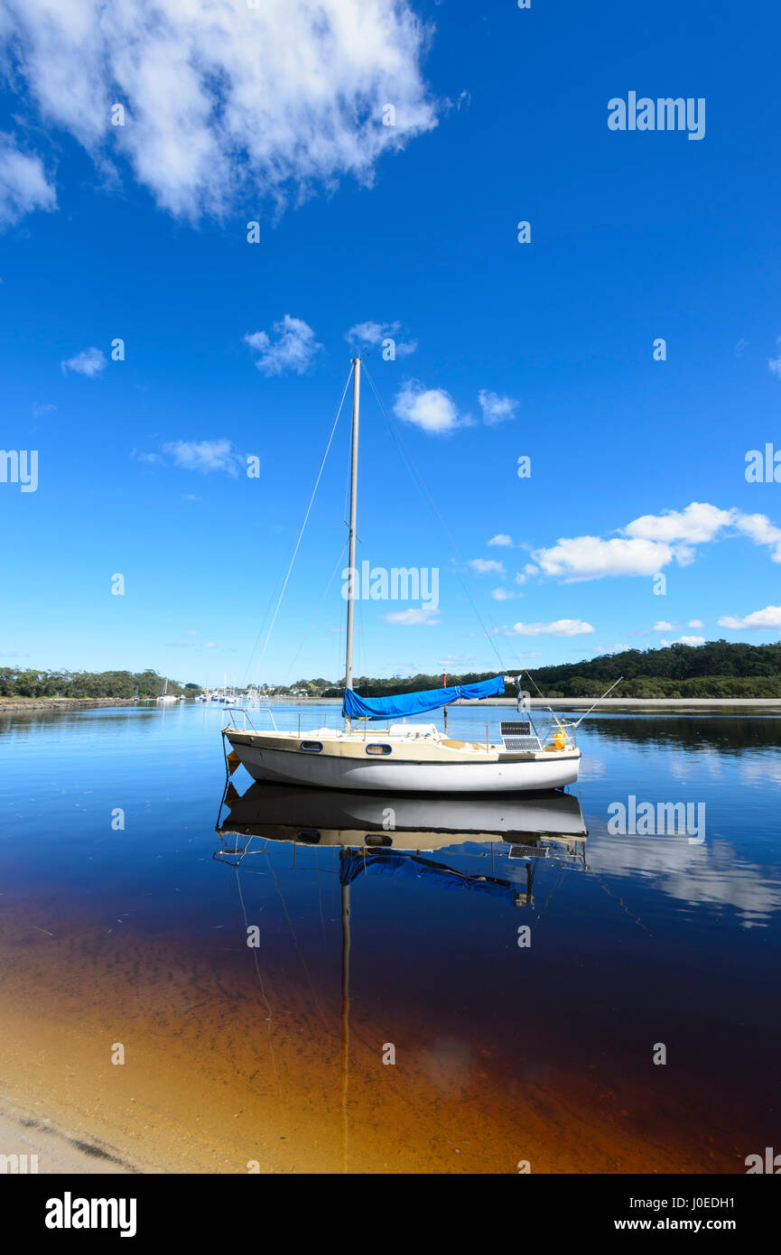 Sailing Boat moored in tannin-stained Currambene Creek, Huskisson, South Coast, New South Wales, NSW, Australia Stock Photo