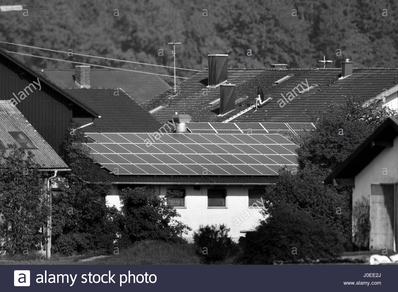 Europe, Germany, Bavaria, View Of Solar Panels On Roof Of Private House - Stock Image