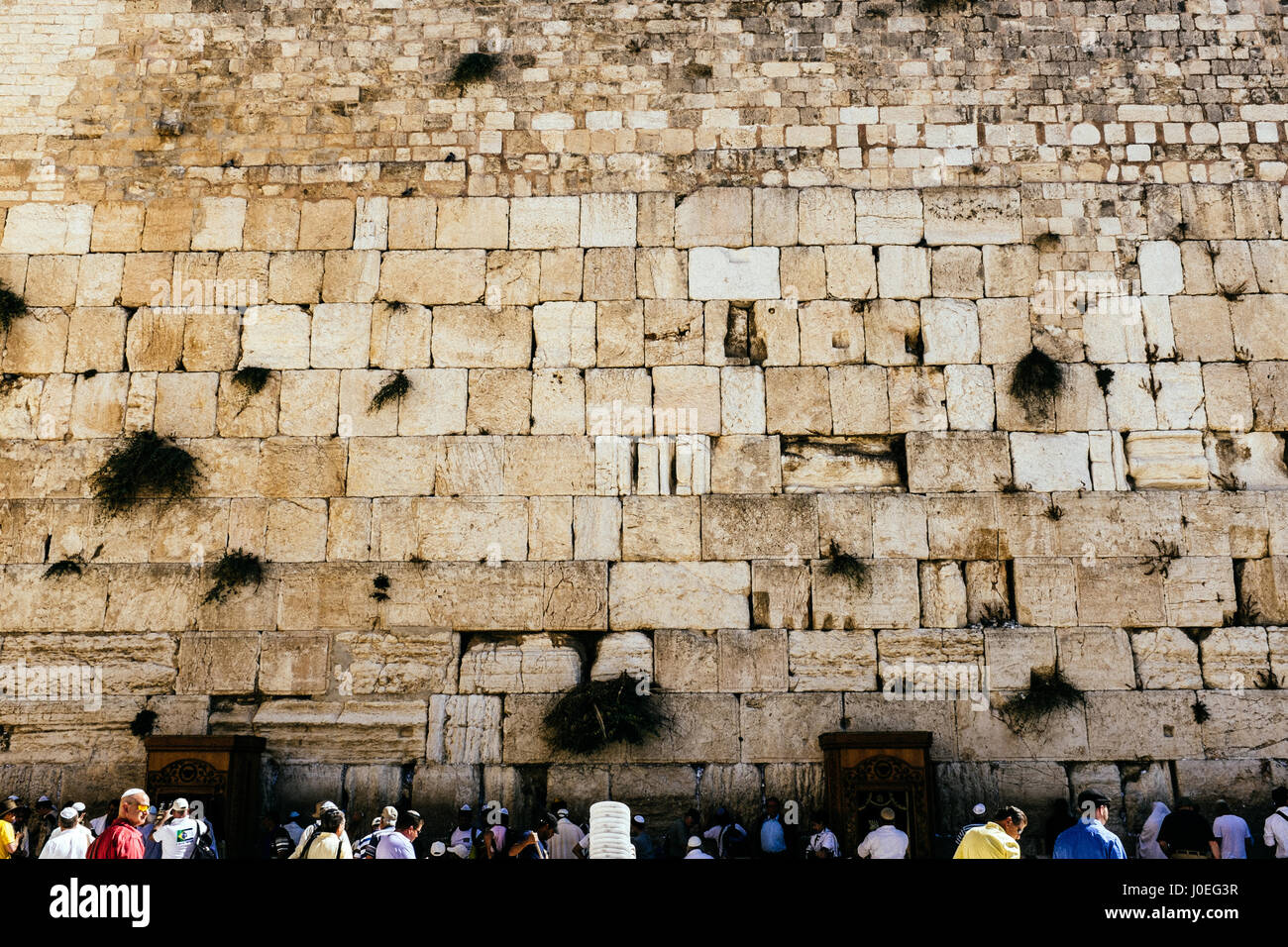 The area in front of the Wailing Wall is a lively place: religious or secular Jews blend together with tourist in - Stock Image