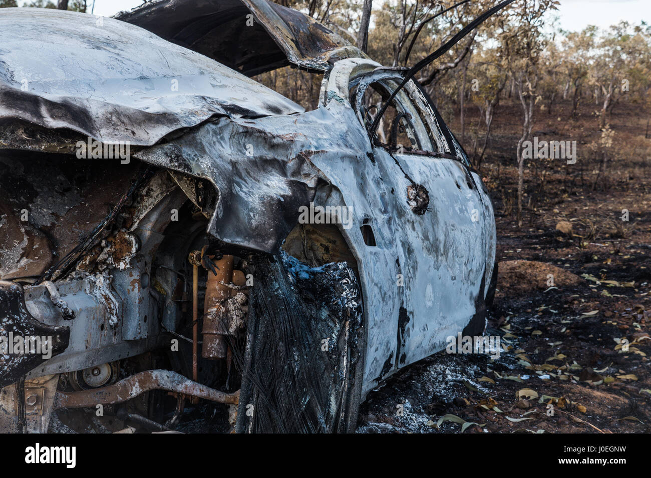 Burnt out car in Katherine National Park - Stock Image