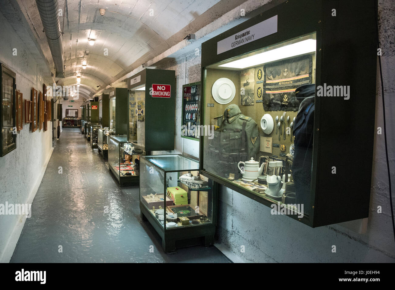 A tunnel of displayed exhibits at the La Valette Underground Military museum in St.Peter Port in Guernsey in the - Stock Image