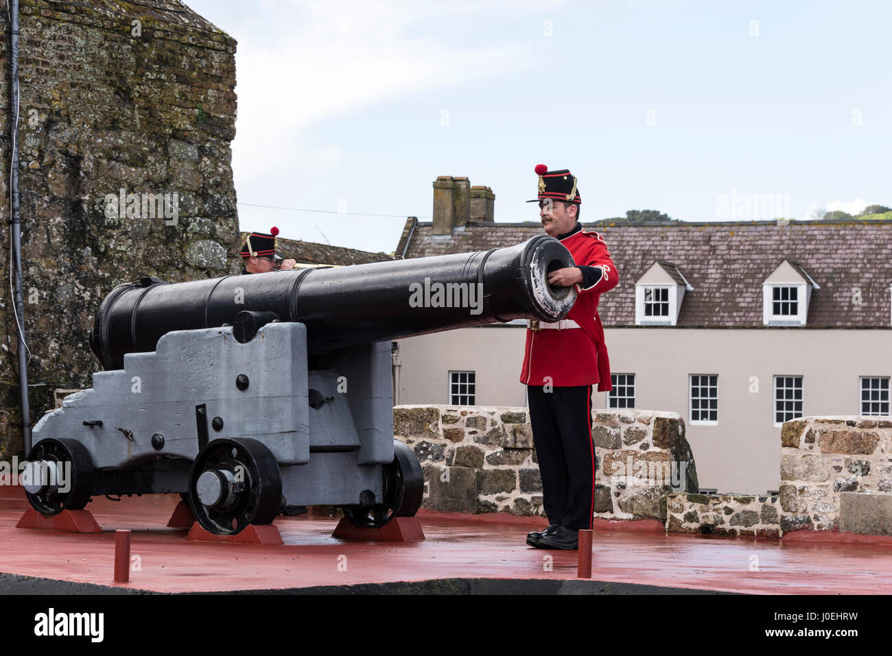 Pix shows: The sergeant  loads the cannon or 'noon-gun' with black powder.  One of the big visitors attraction - Stock Image