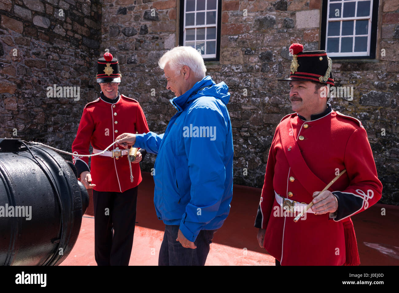 Pix shows: A visitor tries his hand at pulling the cord on the noon-gun   It is One of the big visitors attraction - Stock Image