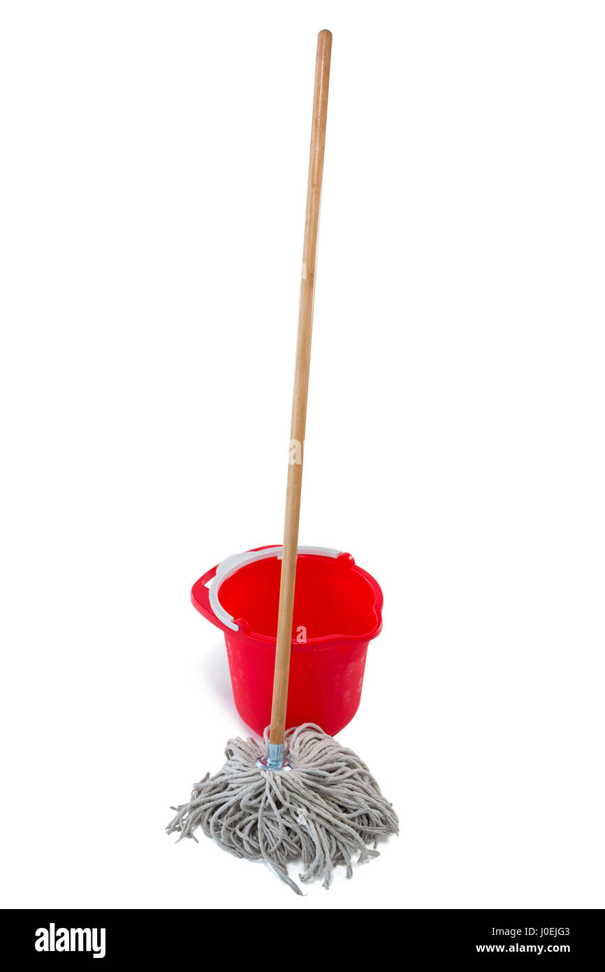 Mop with red bucket against white background - Stock Image