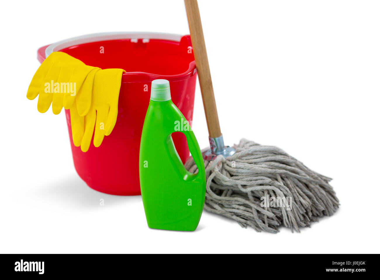 Close up of chemical bottle and mop with bucket against white background - Stock Image