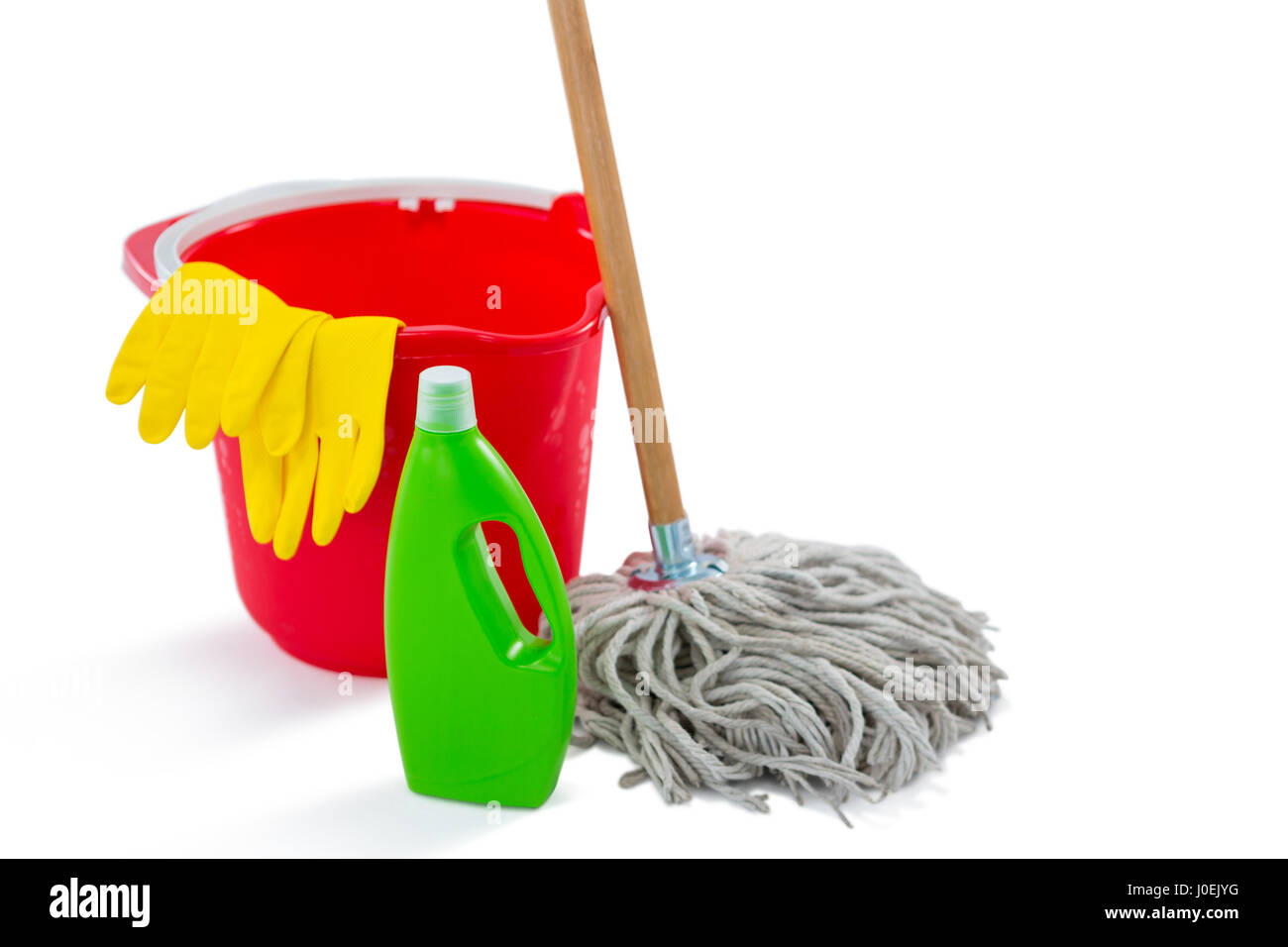 Close up of cleaning products and mop with bucket against white background - Stock Image