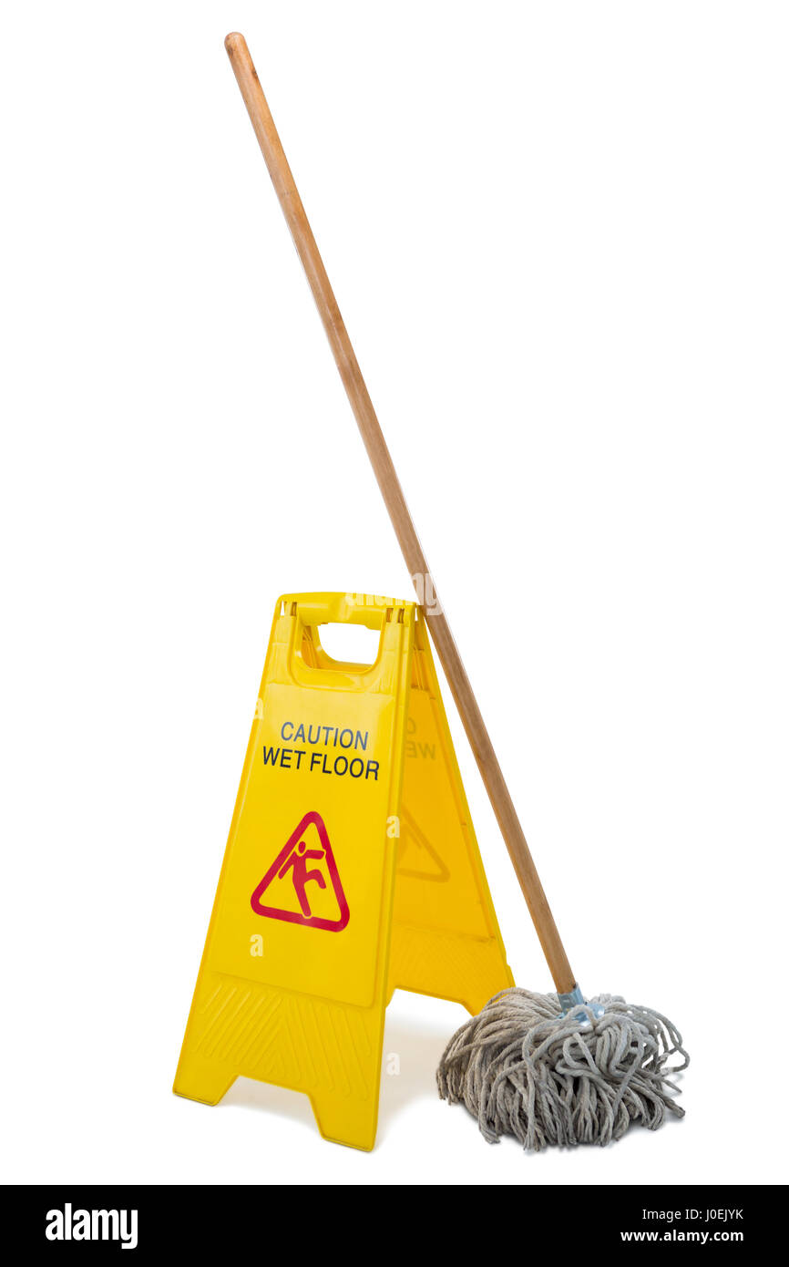Yellow sign board with mop against white background - Stock Image