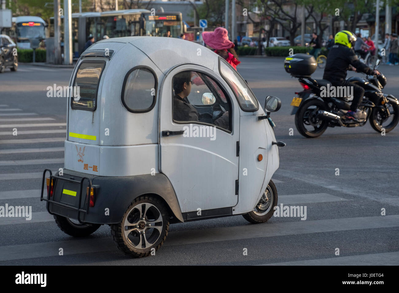 An unlicensed mini electric car is seen in Beijing, China. 11-Apr-2017 Stock Photo