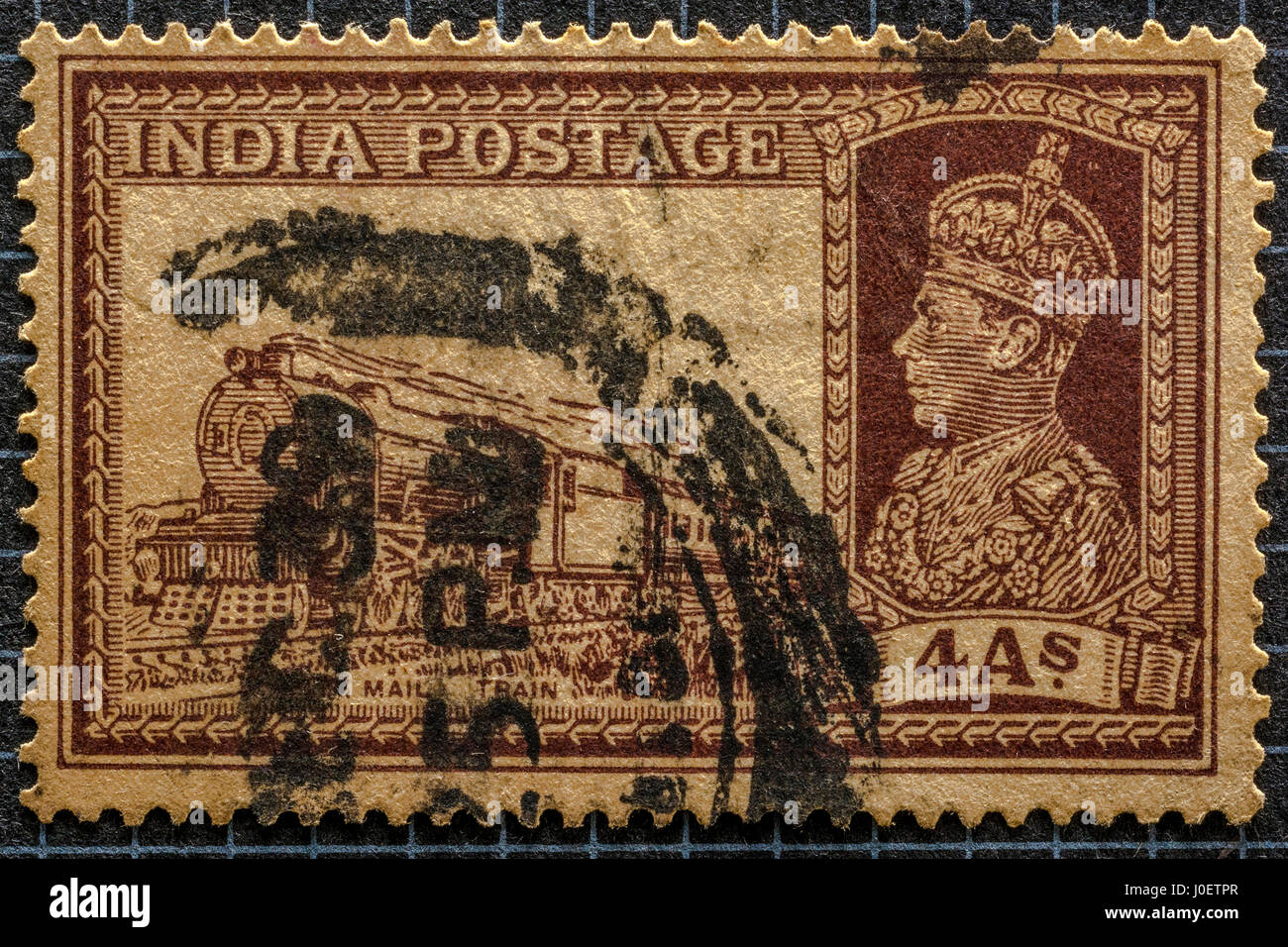 old vintage Transport mail train 4 annas, postage stamps, india, asia - Stock Image