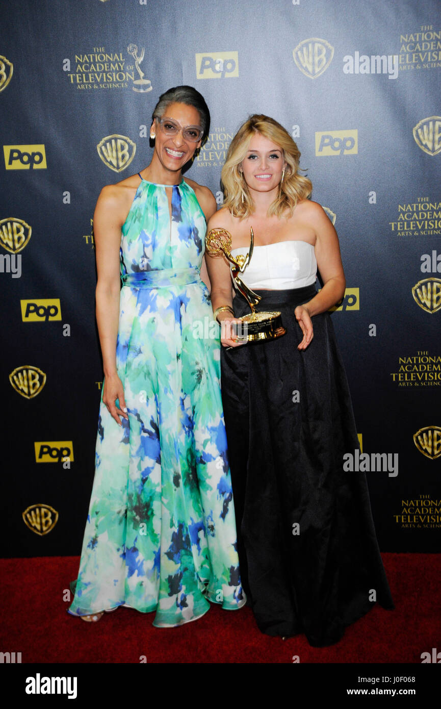TV personalities Carla Hall (L) and Daphne Oz pose in the press room at The 42nd Annual Daytime Emmy Awards at Warner - Stock Image