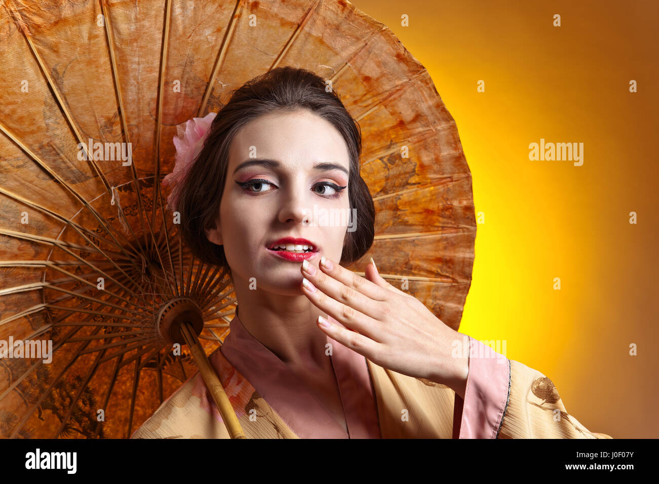 Young Beautiful Woman In Traditional Japanese Kimono With