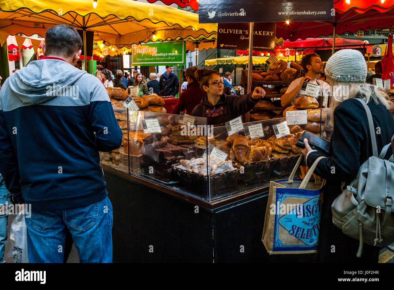 People Shopping At Olivier's Bakery In Borough Market, Southwark, London, England - Stock Image