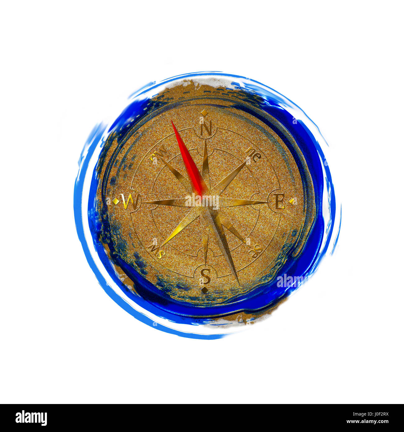 Top view of compass in beach sand - Stock Image