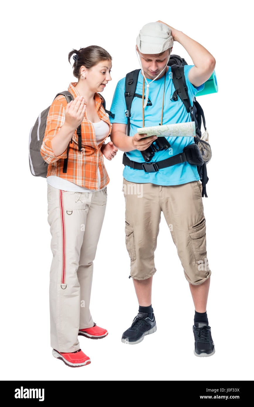 Two lost tourists look at the map on a white background in the studio Stock Photo