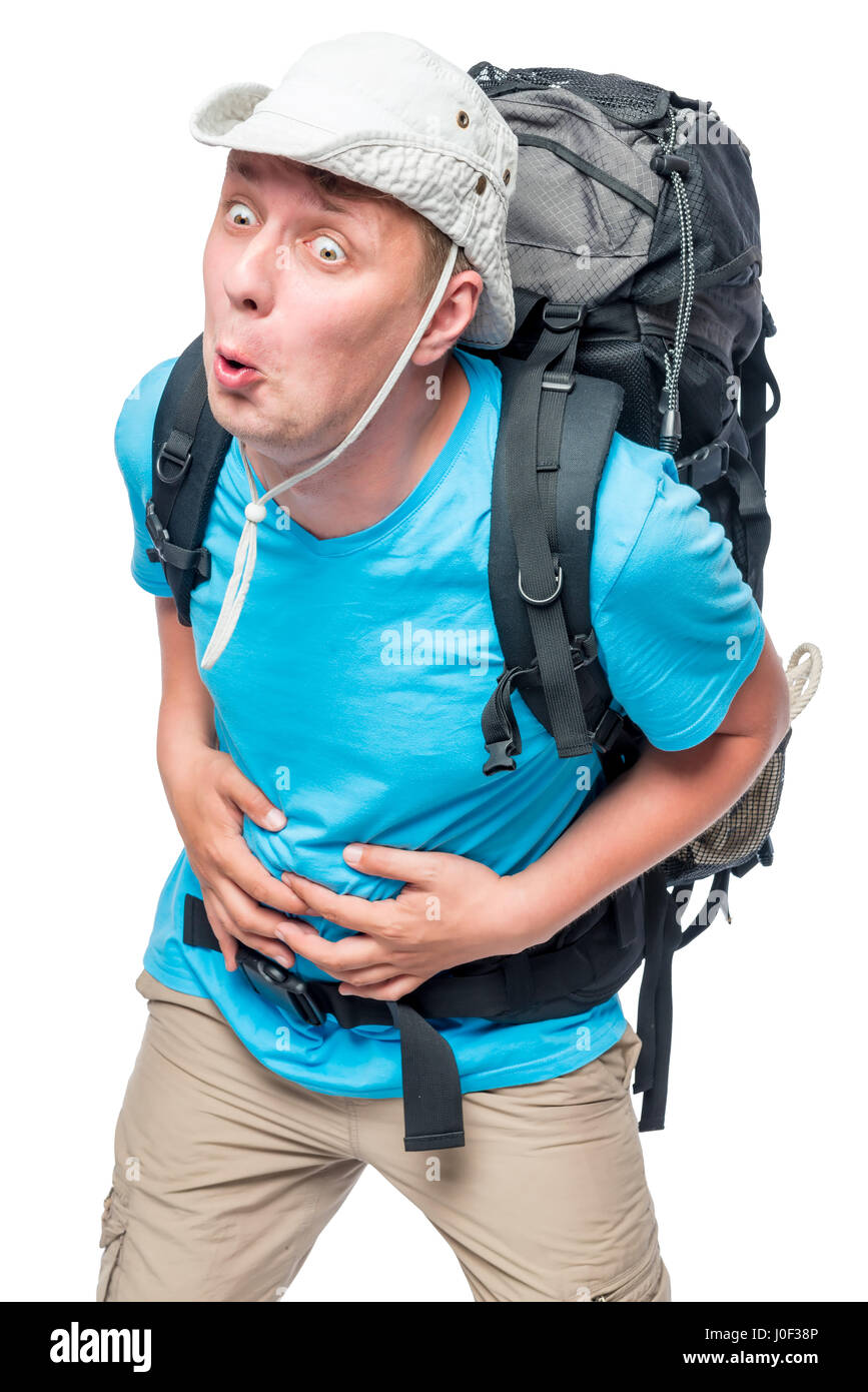 Acute pain in the belly of a tourist carrying a heavy backpack - Stock Image