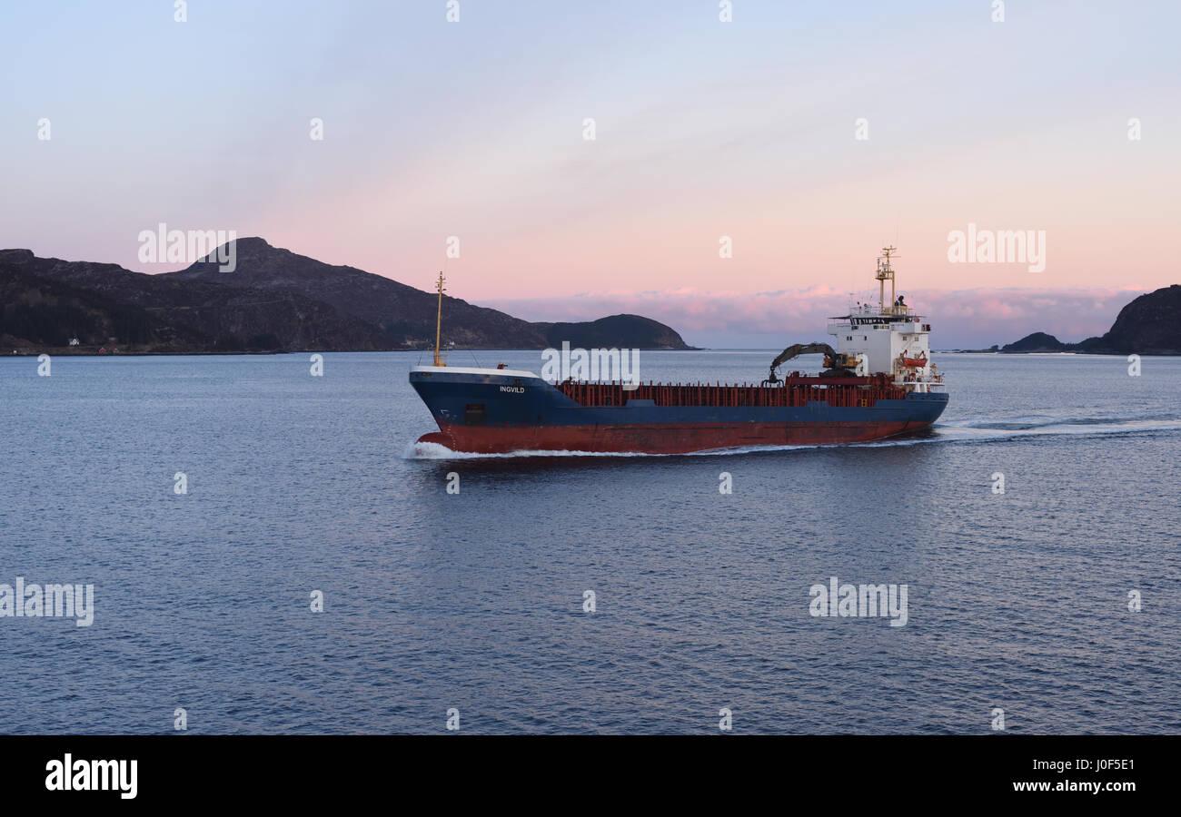 The Norwegian general cargo ship Ingvild off the Stad or Stadlandet peninsula. Selje, Sogn og Fjordane, Norway. - Stock Image