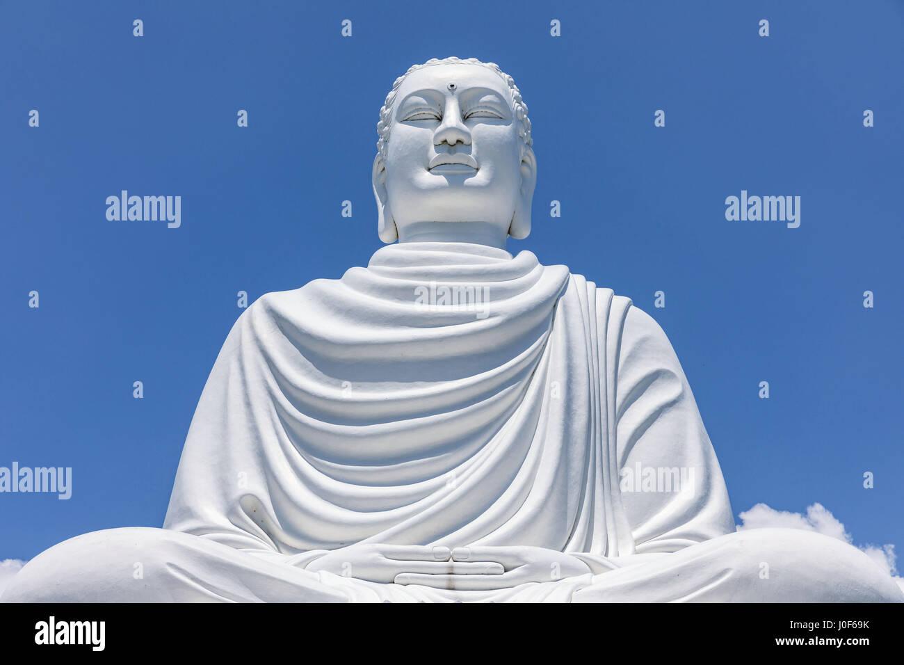 White Buddha Statue at Long Son Pagoda in sunny day at Nha Trang, Vietnam Stock Photo