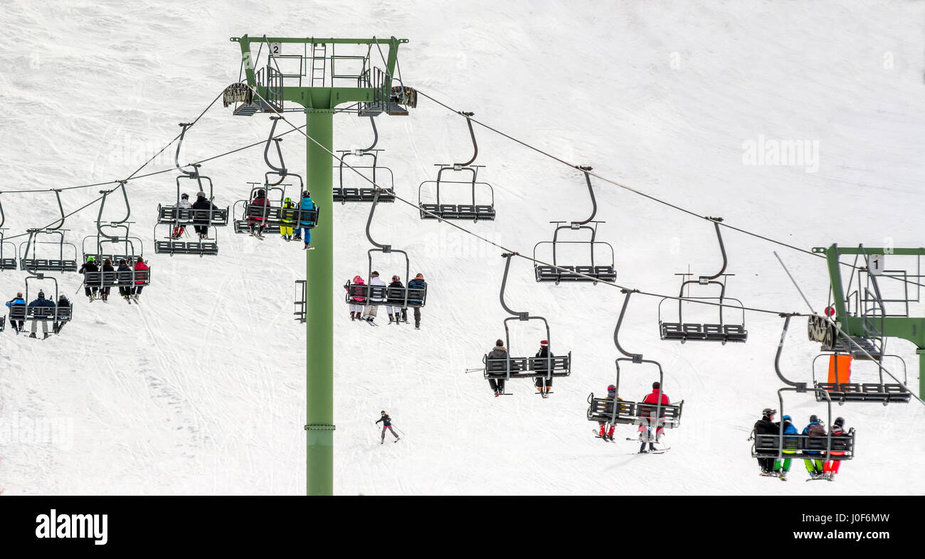 Row of chairlifts. Le Mont Dore ski resort, Auvergne, France - Stock Image
