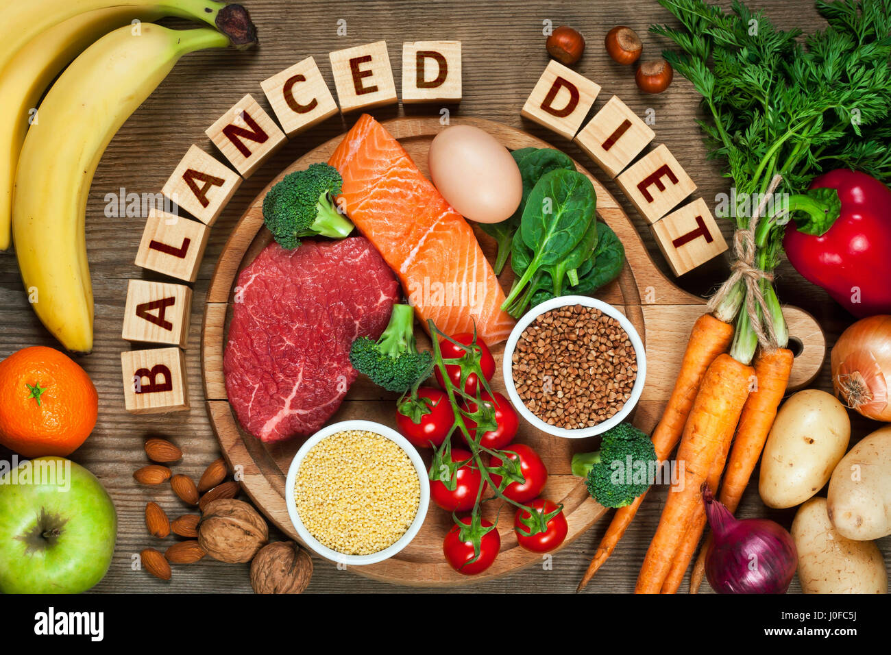 Balanced diet - healthy food on wooden table - Stock Image