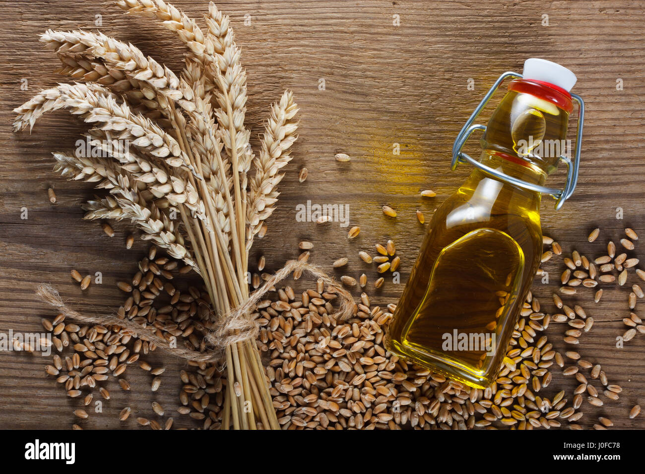 Wheat grain and wheat germ oil - Stock Image