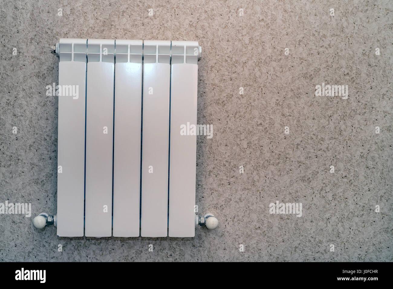 Close-up of modern hot water baseboard radiator - Stock Image
