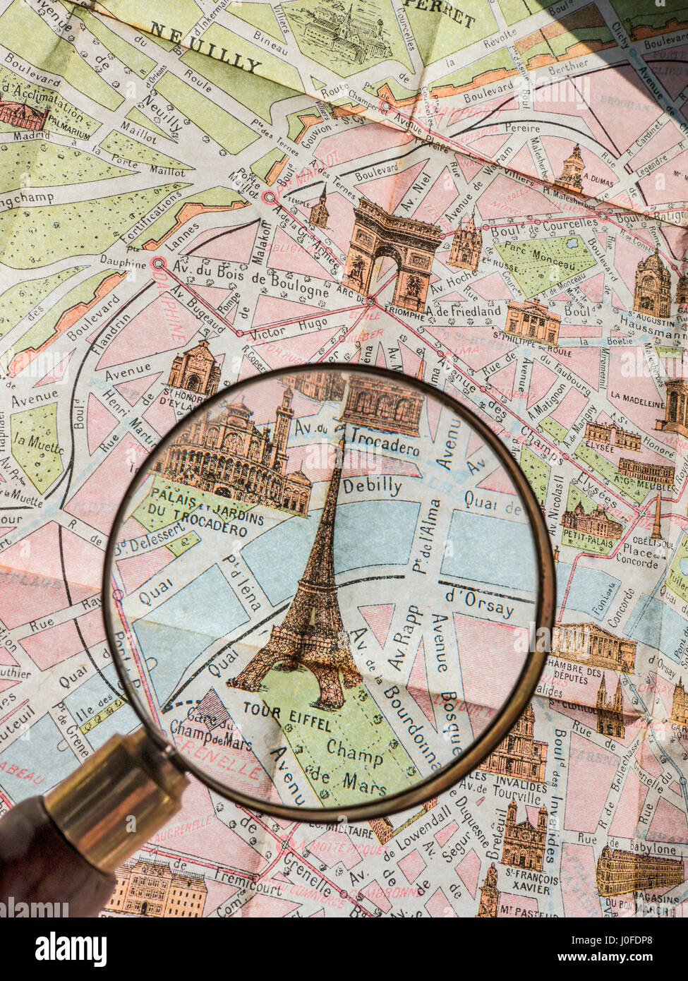 Magnifying Glass on fine print detail of rare 1900's vintage retro colour Monumental Map of Paris, featuring - Stock Image