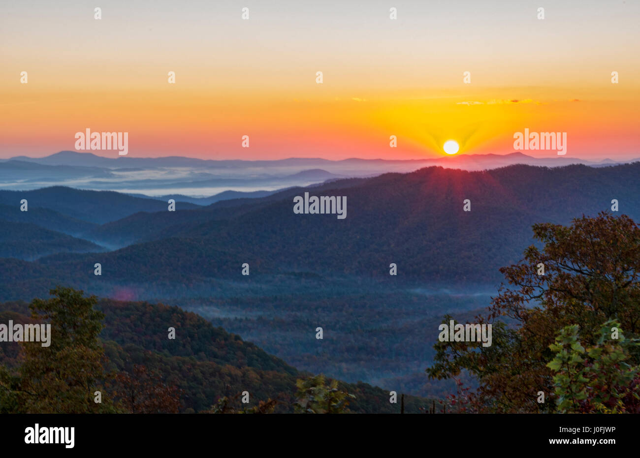 Brevard North Carolina mountains near Asheville Fall Colors Blue Ridge Highway sunrise hills ridges - Stock Image