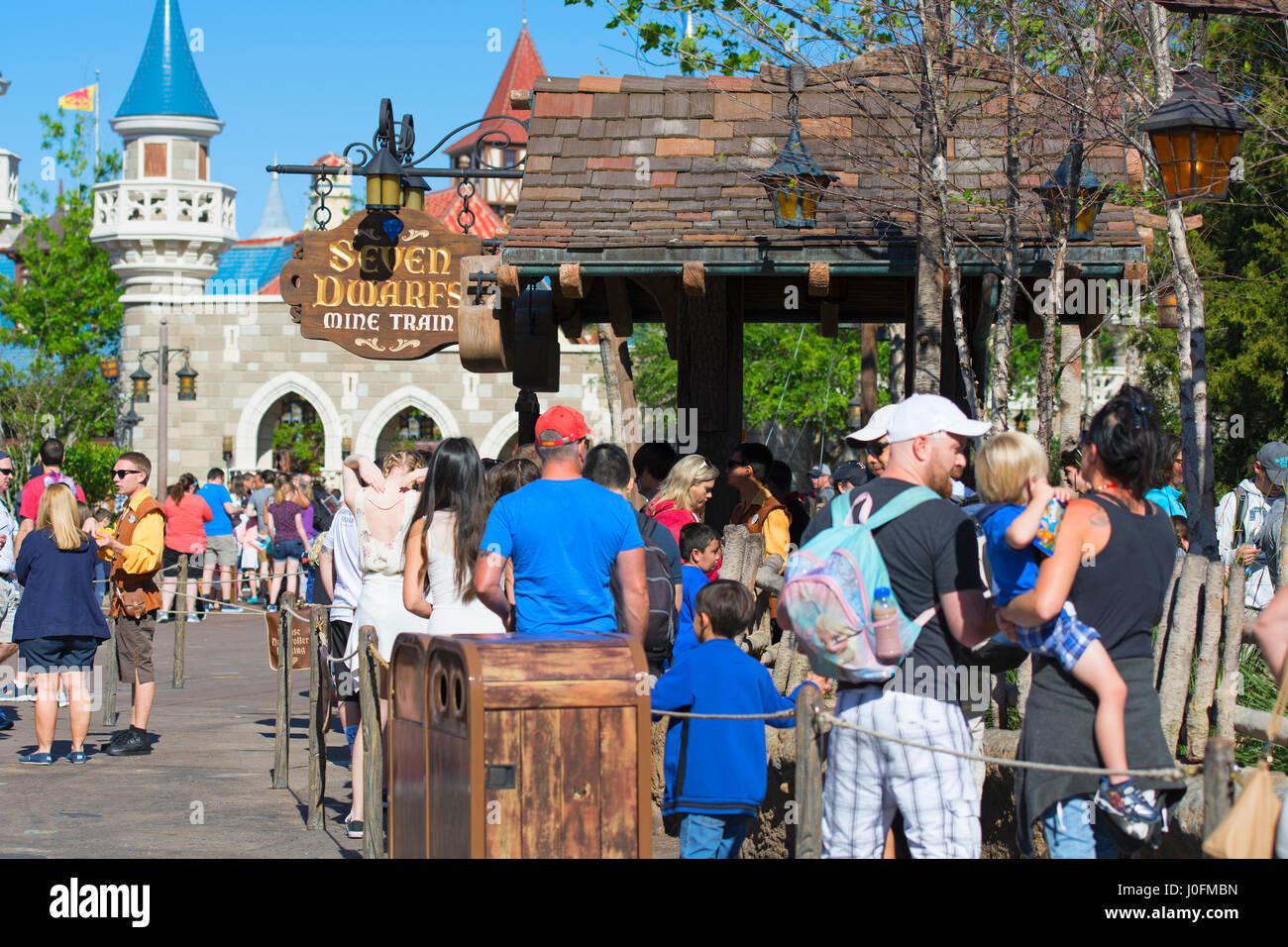 Queue for Seven Dwarfs Mine Train ride Family Children, Disney World, Magic Kingdom, Orlando Florida - Stock Image