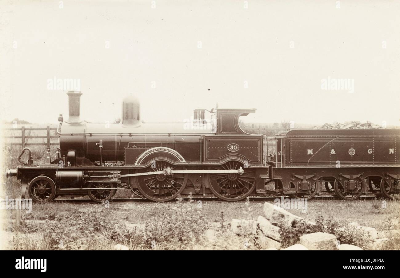 Locomotive no 30: 4-4-0 engine, on the nameplate 'Beyer Peacock & Co Ltd Manchester...' - Stock Image