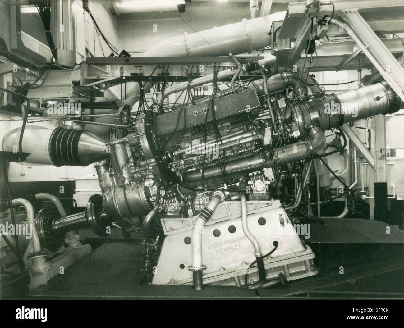 The C18-5 compound Deltic prototype under load in the Acton Marine Engine Test House - Stock Image