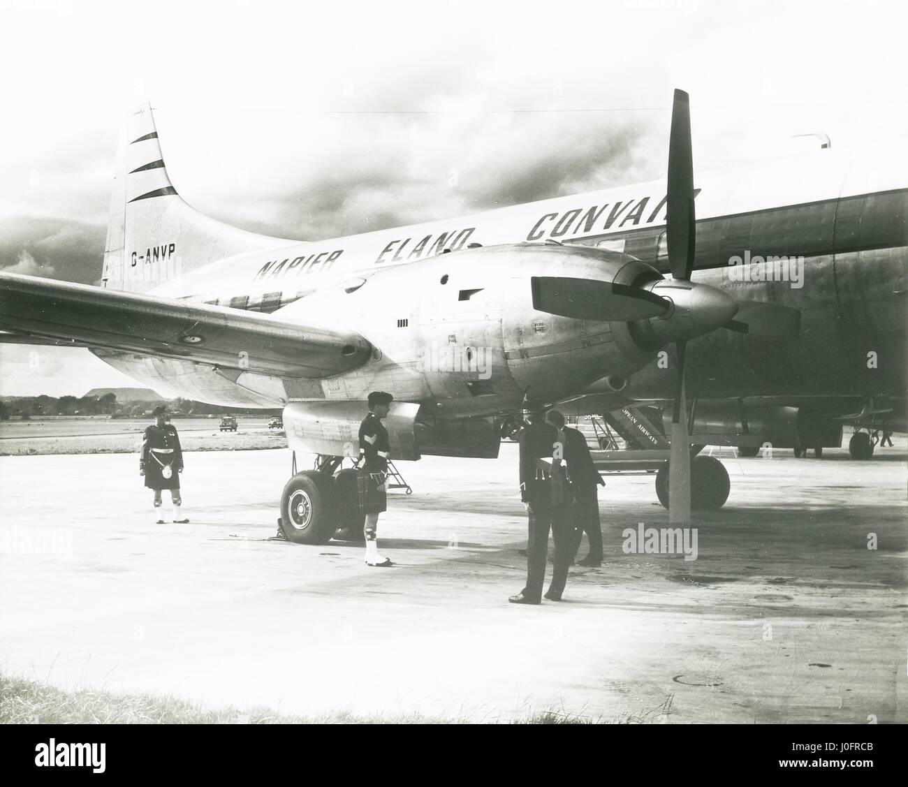 Napier Eland Airliner G ANVP converted with turboprop engines on runway with men in kilts - Stock Image