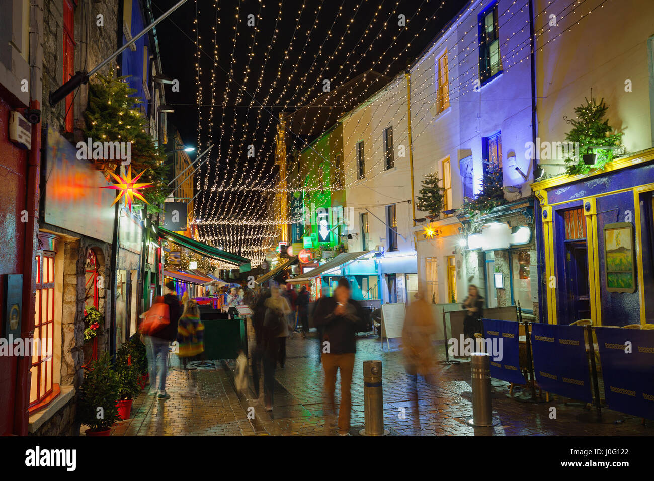 Shop street decorated with Christmas lights. Galway, Ireland - Stock Image
