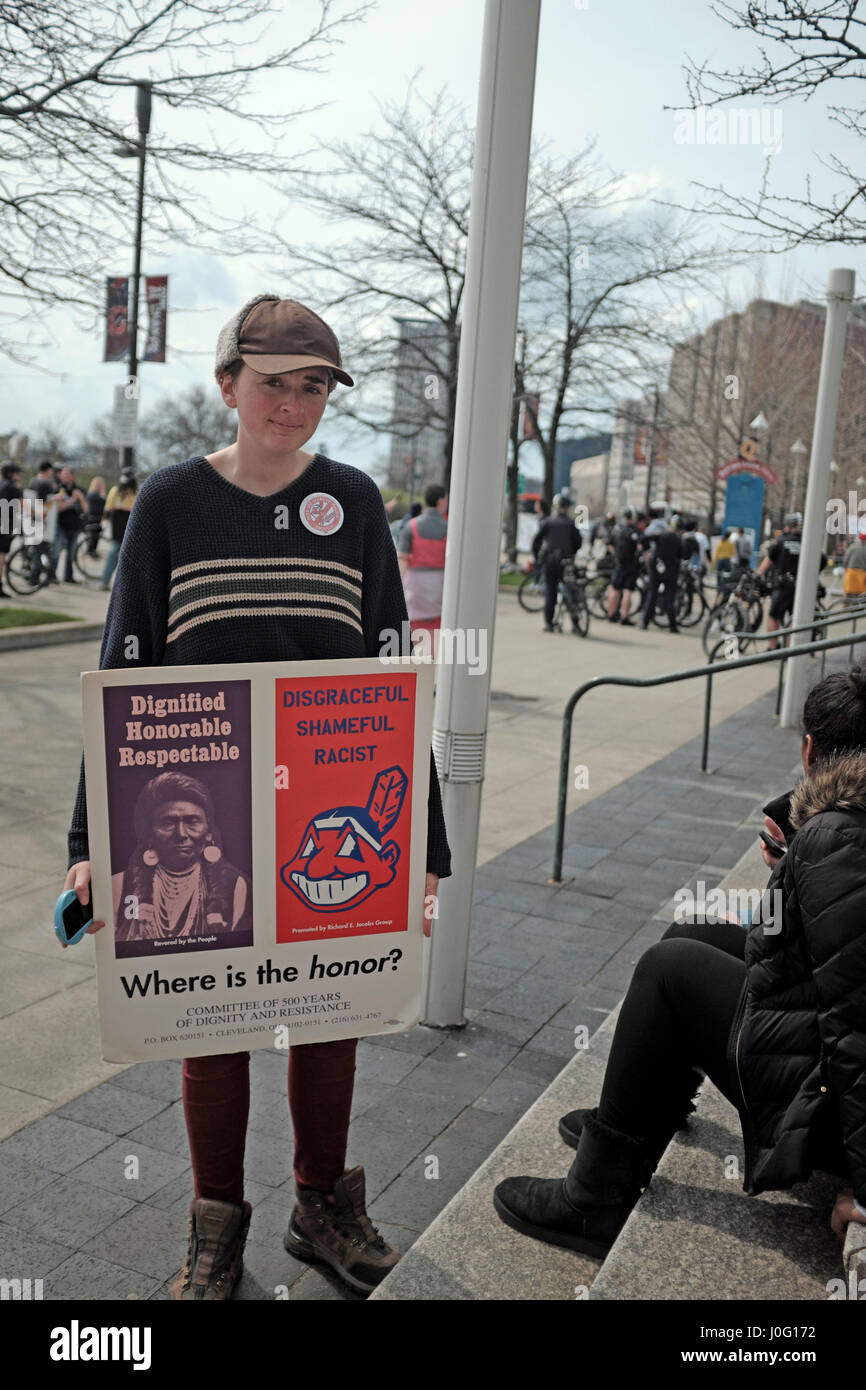 Woman protesting use of the Chief Wahoo mascot by the Cleveland Indians organization in Cleveland, Ohio, USA on - Stock Image