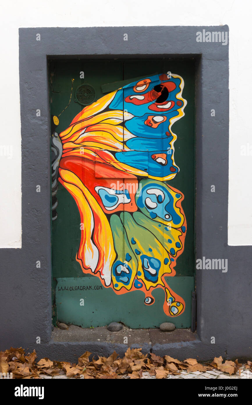 A painted butterfly wing; part of a series of painted doorways in Machico, Madeira - Stock Image