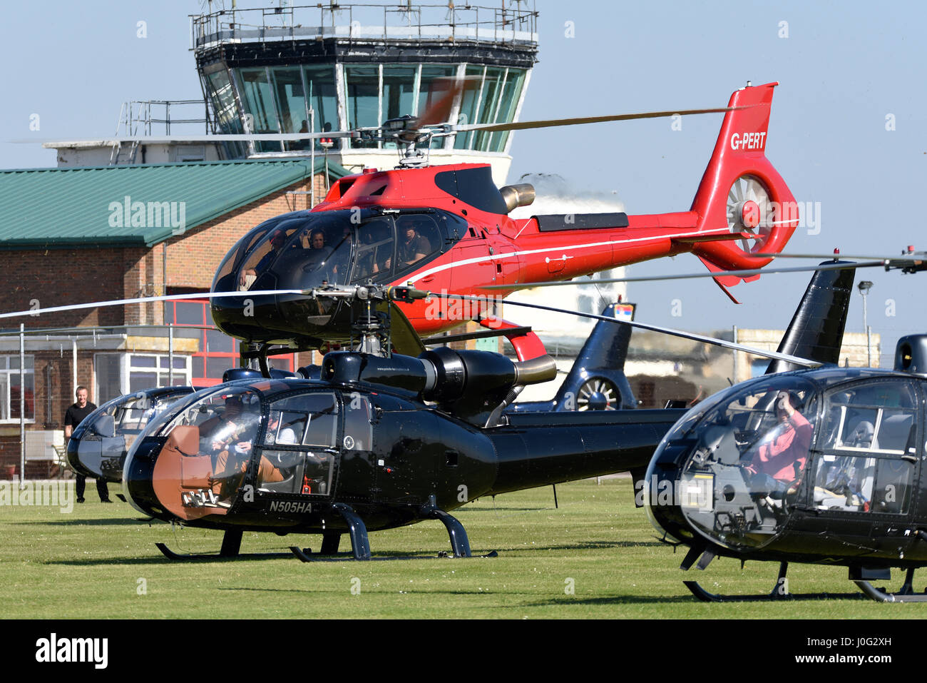 Aerospatiale Gazelle and EC130 helicopters seen here at the Gazelle 50th anniversary fly-in at Middle Wallop. The - Stock Image