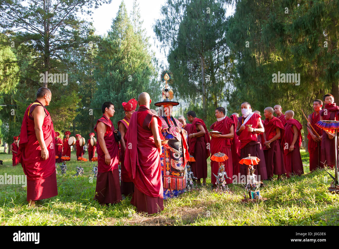 Monks carrying out Buddhist ceremony, Punakha Dzong (monastery), Punakha, Bhutan - Stock Image