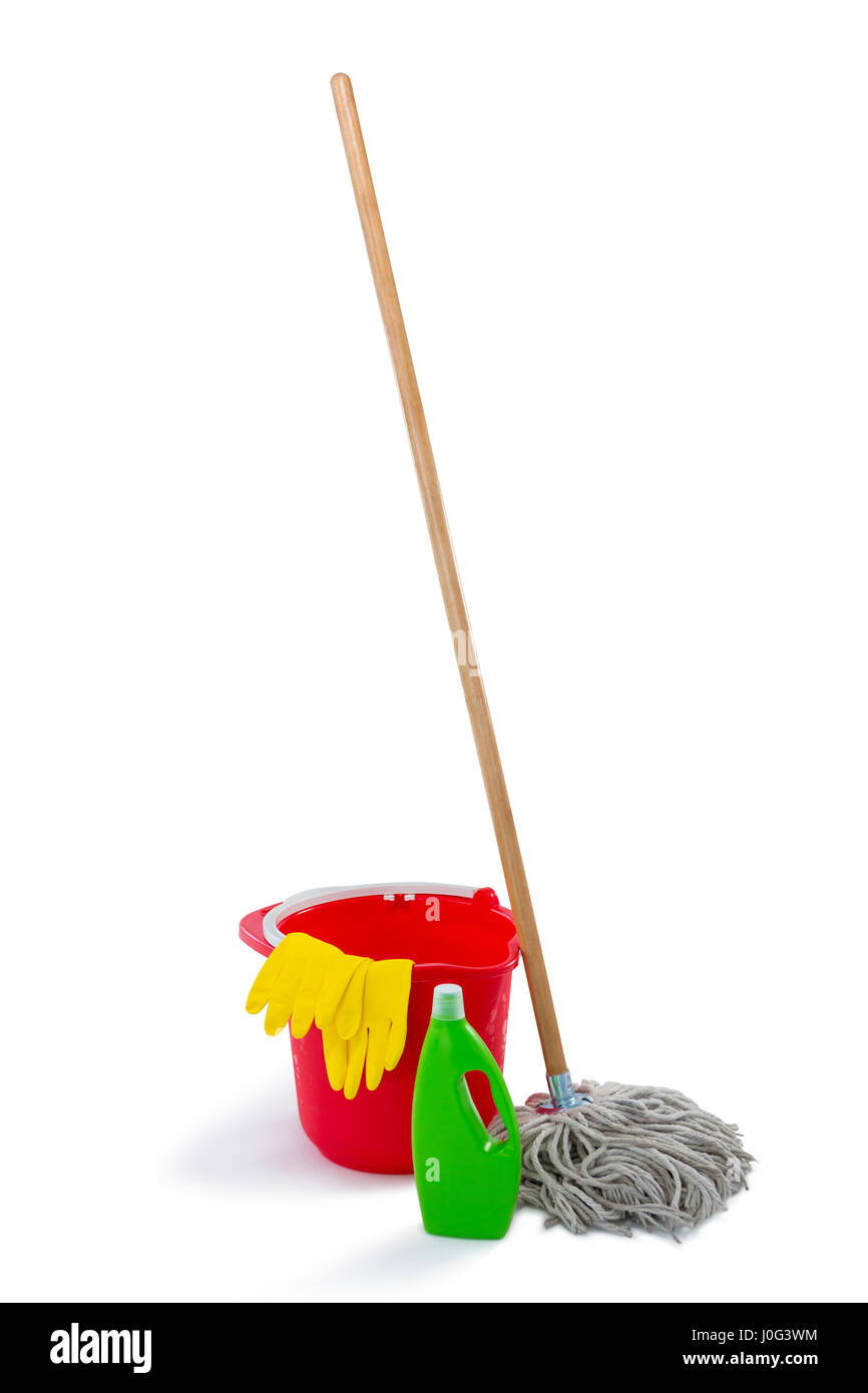 Cleaning products and mop with bucket against white background - Stock Image