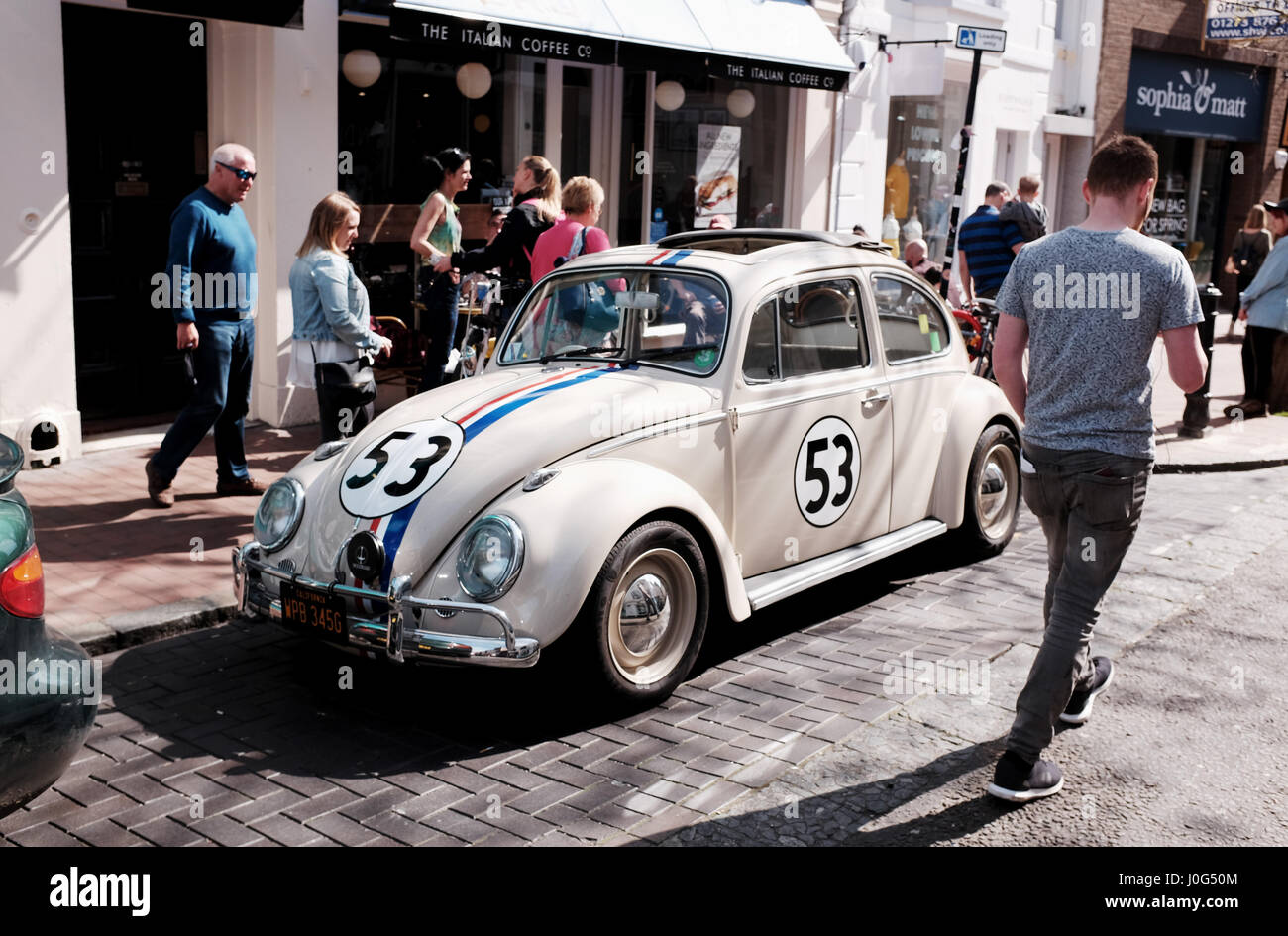 Old Volkswagen Beetle car painted in same colours as from the famous film Herbie spotted parked in Brighton UK - Stock Image
