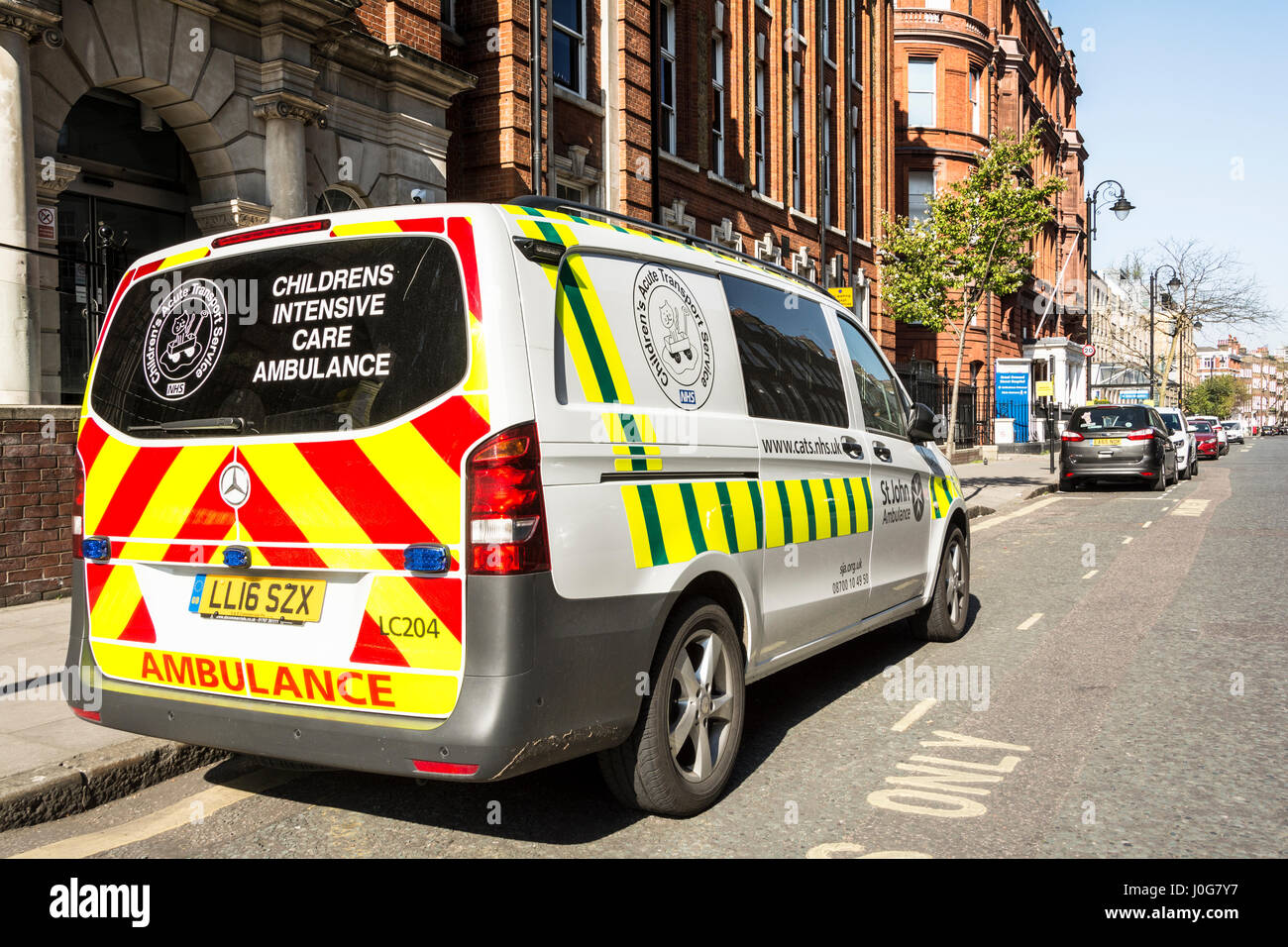 A childrens intensive care ambulance parked outside Great Ormond Street hospital, London, WC1, England, UK - Stock Image