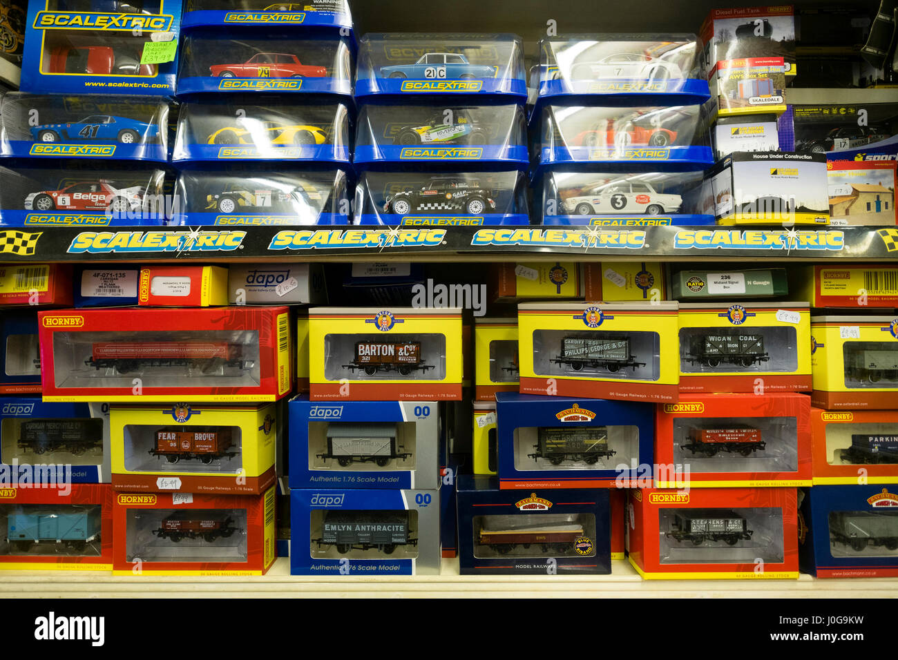 Boxes of Hornby model trains  and Scalextric on sale in the   'The Albatross' traditional old-fashioned - Stock Image