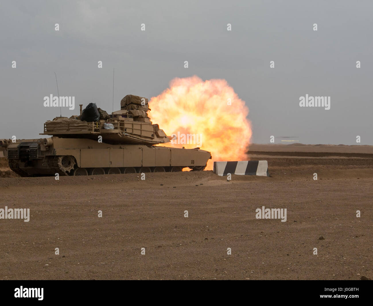 A 3rd Armored Brigade Combat Team, 1st Cavalry Division M1A2 Abrams Main Battle Tank engages targets during the Stock Photo