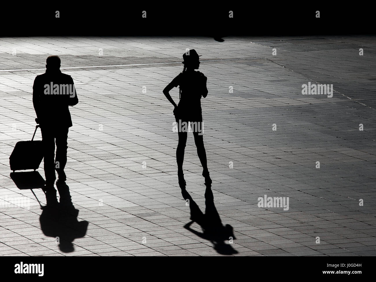 silhouette of a beautiful woman waiting outside airport Stock Photo