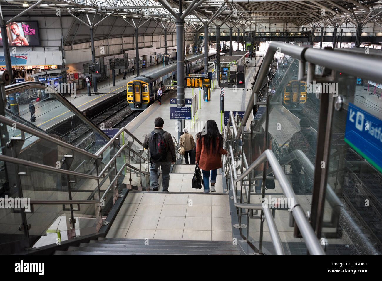 Leeds City Railway Station, Leeds, West Yorkshire, UK, with Sprinter train to Manchester waiting at platform - Stock Image