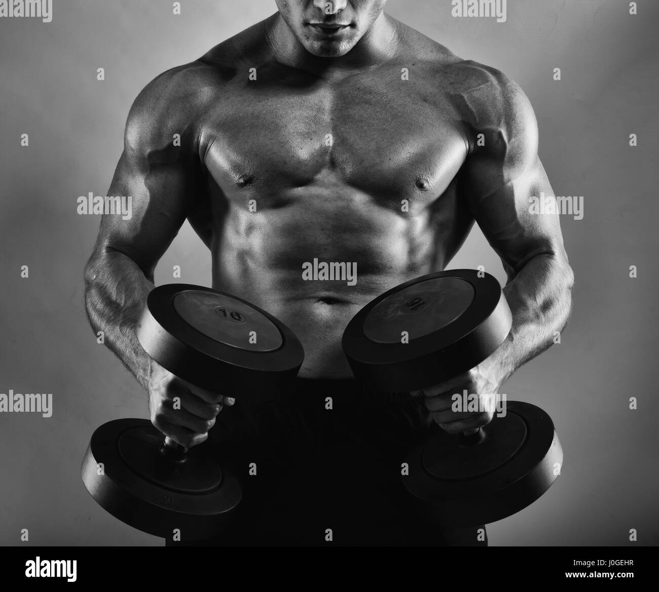 Athletic man training biceps - Stock Image