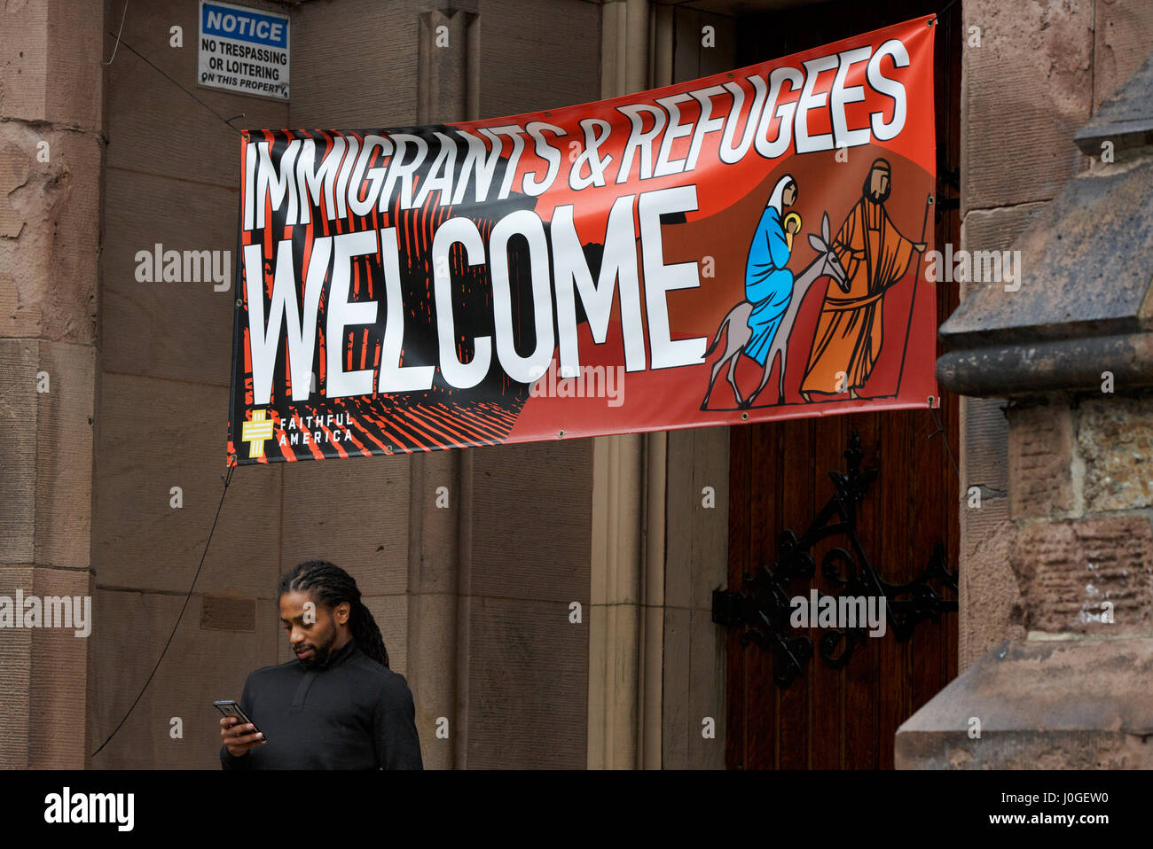 Pro immigrant immigration sign on Church of the Covenant,. Boston, Massachusetts - Stock Image