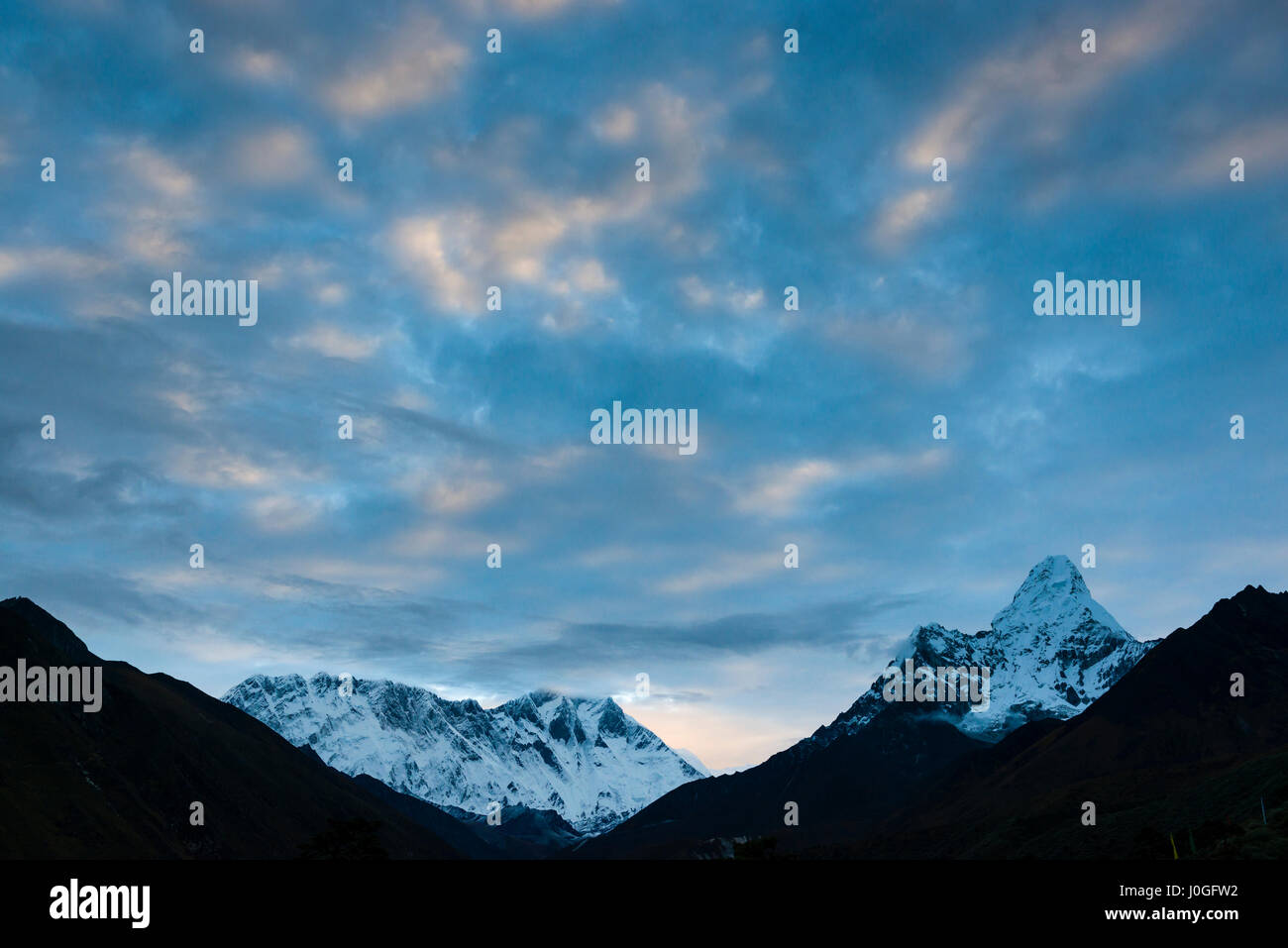 Lhotse and Ama Dablam at dawn, seen from Tengboche, Nepal. Photo © robertvansluis.com - Stock Image