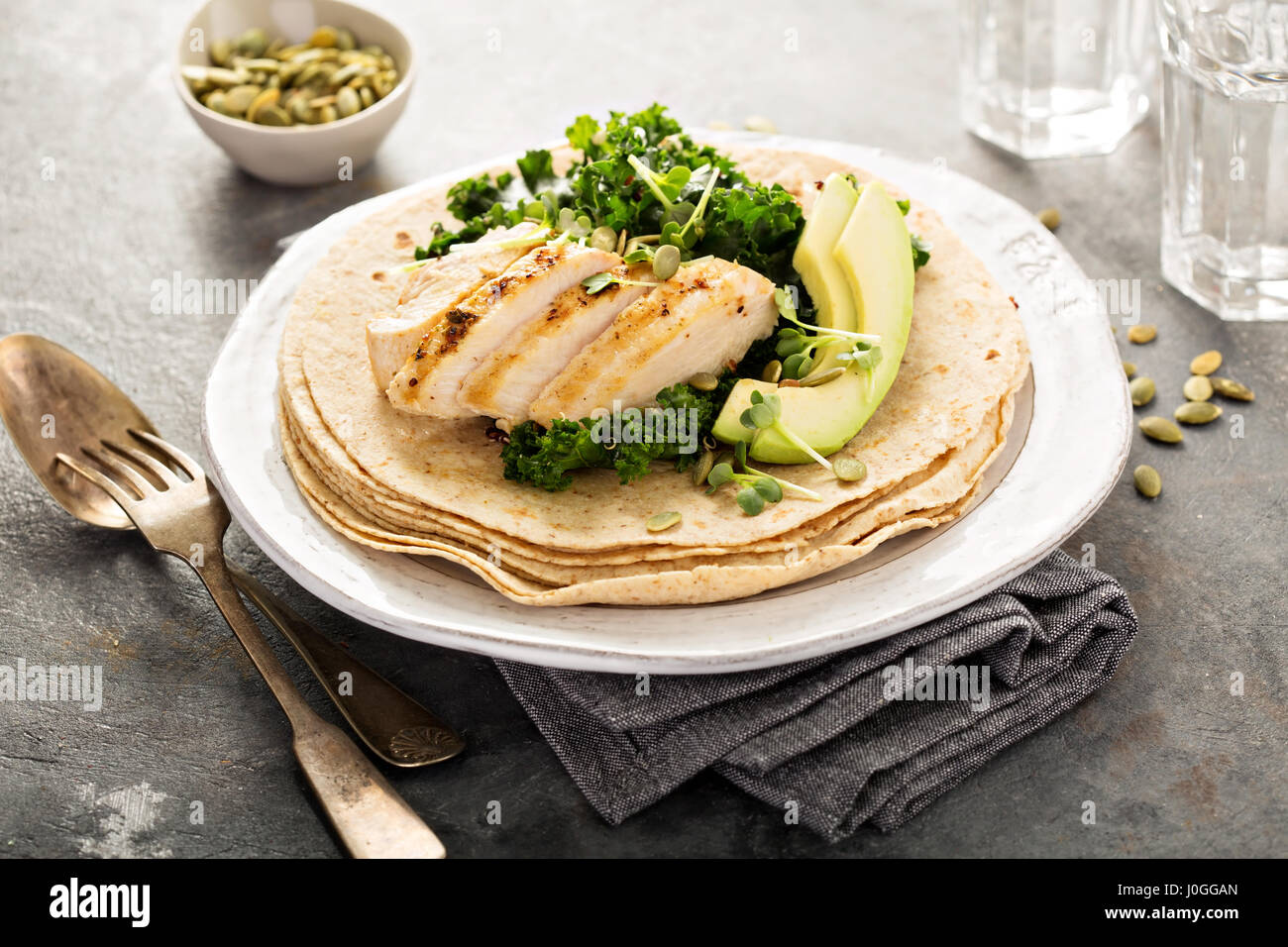 Making tacos with grilled chicken and avocado - Stock Image