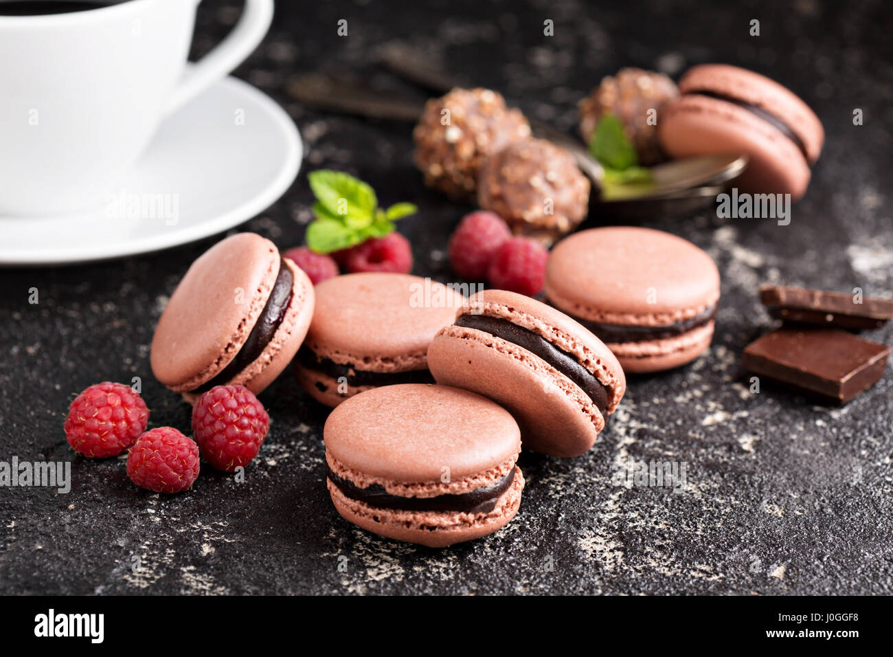 Chocolate and raspberry french macarons with ganache filling - Stock Image