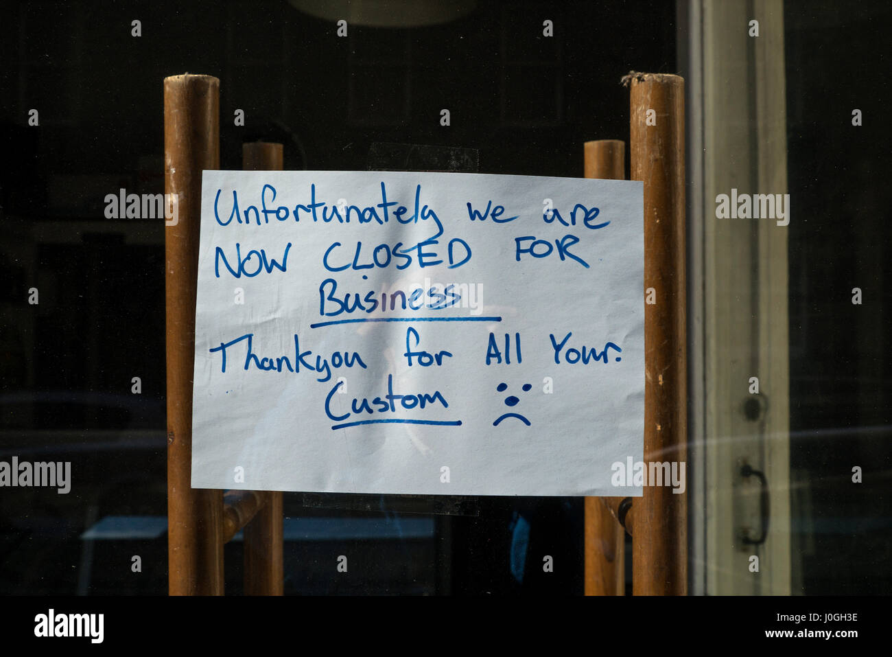 Sign on the window of a small food retail shop which has just closed for good. Stock Photo