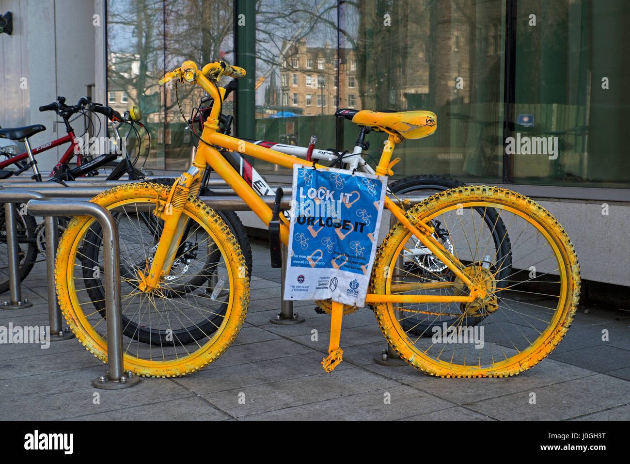 'Lock It, or Lose It' poster, part of the University of Edinburgh's bicycle security campaign. - Stock Image